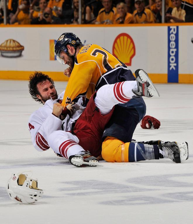 NASHVILLE, TN - MAY 04:  Paul Gaustad #28 of the Nashville Predators fights with Kyle Chipchura #24 of the Phoenix Coyotes in Game Four of the Western Conference Semifinals during the 2012 NHL Stanley Cup Playoffs at the Bridgestone Arena on May 2, 2012 in Nashville, Tennessee.  (Photo by Frederick Breedon/Getty Images)