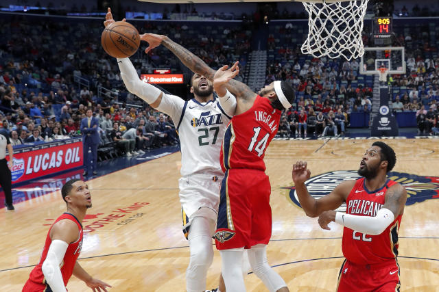 New Orleans Pelicans forward Brandon Ingram (14) stops Utah Jazz center Rudy Gobert (27) on a drive to the basket during the first half of an NBA basketball game in New Orleans, Thursday, Jan. 16, 2020. (AP Photo/Gerald Herbert)