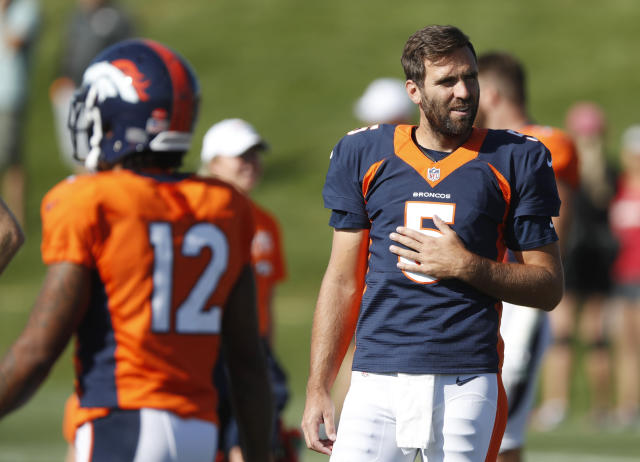 Denver Broncos quarterback Joe Flacco takes a break during a combined NFL training camp with the San Francisco 49ers Saturday, Aug. 17, 2019, at the Broncos' headquarters in Englewood, Colo. (AP Photo/David Zalubowski)