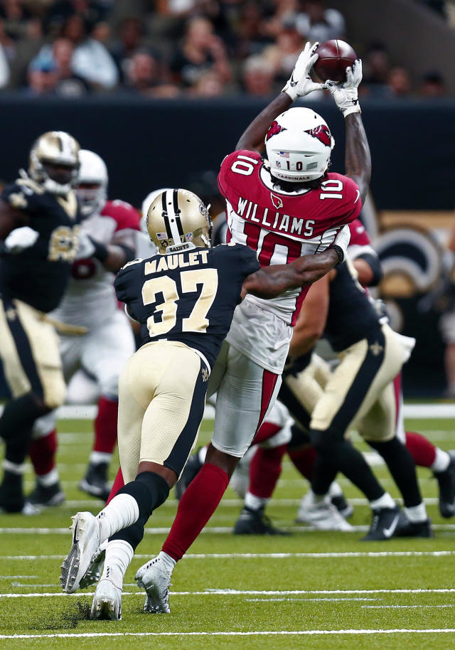 Arizona Cardinals wide receiver Chad Williams (10) pulls in a pass as New Orleans Saints cornerback Arthur Maulet (37) covers in the first half of an NFL preseason football game in New Orleans, Friday, Aug. 17, 2018. (AP Photo/Butch Dill)