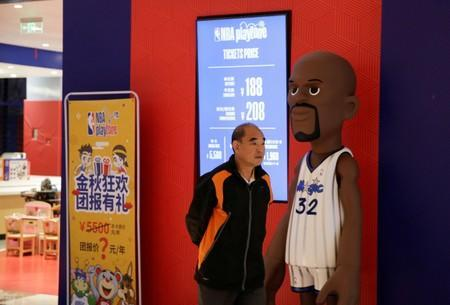 A man walks past the NBA Playzone at a shopping mall in Beijing