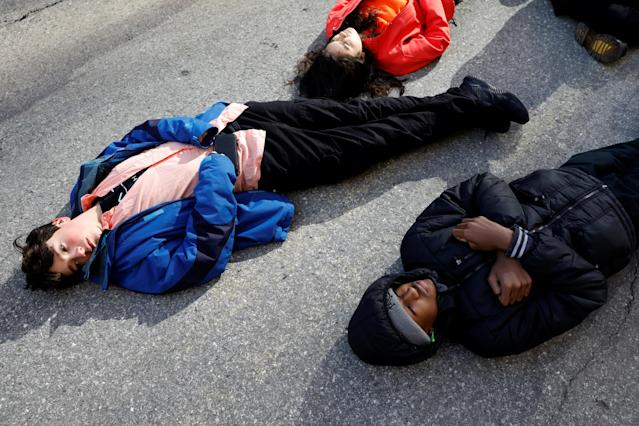 <p>Students from Fiorello H. Laguardia High School lie down on West 62nd street in support of the National School Walkout in the Manhattan borough of New York City, New York, U.S., March 14, 2018. (Photo: Mike Segar/Reuters) </p>