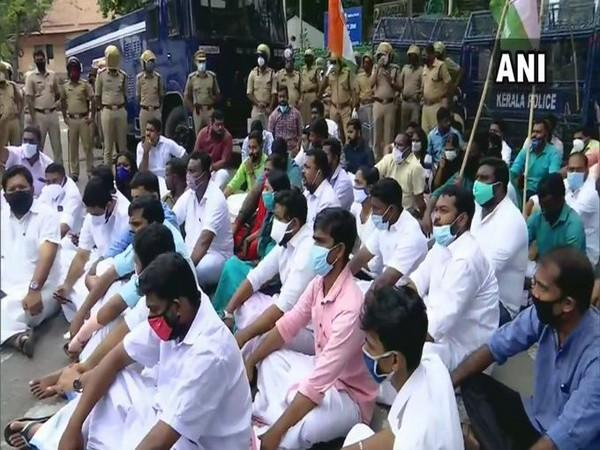 Workers of the Youth Congress protest against Kerala CM Pinarayi Vijayan at the Secretariat, demanding his resignation over gold smuggling case. [Photo/ANI]