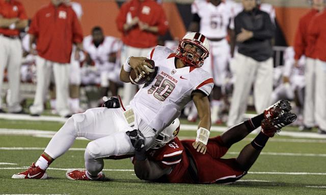 Rutgers quarterback Gary Nova (10) is sacked by Louisville's Roy Philon (93) in the third quarter of an NCAA college football game in Louisville, Ky., Thursday, Oct. 10, 2013. Louisville sacked Nova eight times on the way to a 24-10 victory. (AP Photo/Garry Jones)
