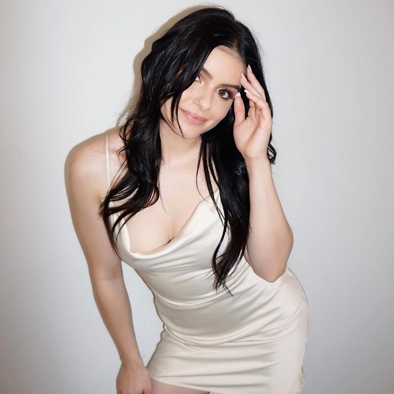 Ariel Winter poses in a white dress