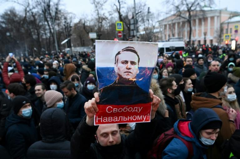 Protesters march in support of jailed opposition leader Alexei Navalny, who was jailed upon returning to Russia after five months in Germany recovering from a near-fatal poisoning, in downtown Moscow on January 23, 2021