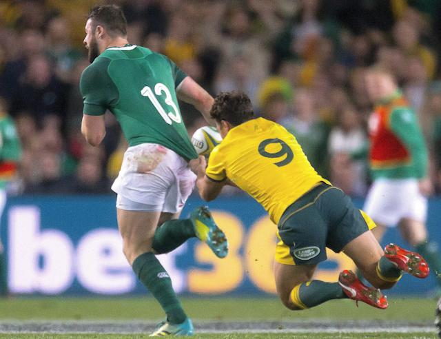 Rugby Union - June Internationals - Australia vs Ireland - Sydney Football Stadium, Sydney, Australia - June 23, 2018 - Nick Phipps of Australia tackles Robbie Henshaw of Ireland. AAP/Craig Golding/via REUTERS ATTENTION EDITORS - THIS IMAGE WAS PROVIDED BY A THIRD PARTY. NO RESALES. NO ARCHIVE. AUSTRALIA OUT. NEW ZEALAND OUT.