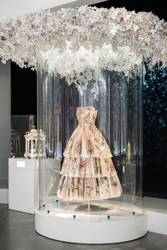 <p>An intricate, tiered strapless gown from the exhibition's Enchanted Garden—an homage to Christian Dior's love for nature and flowers.</p>