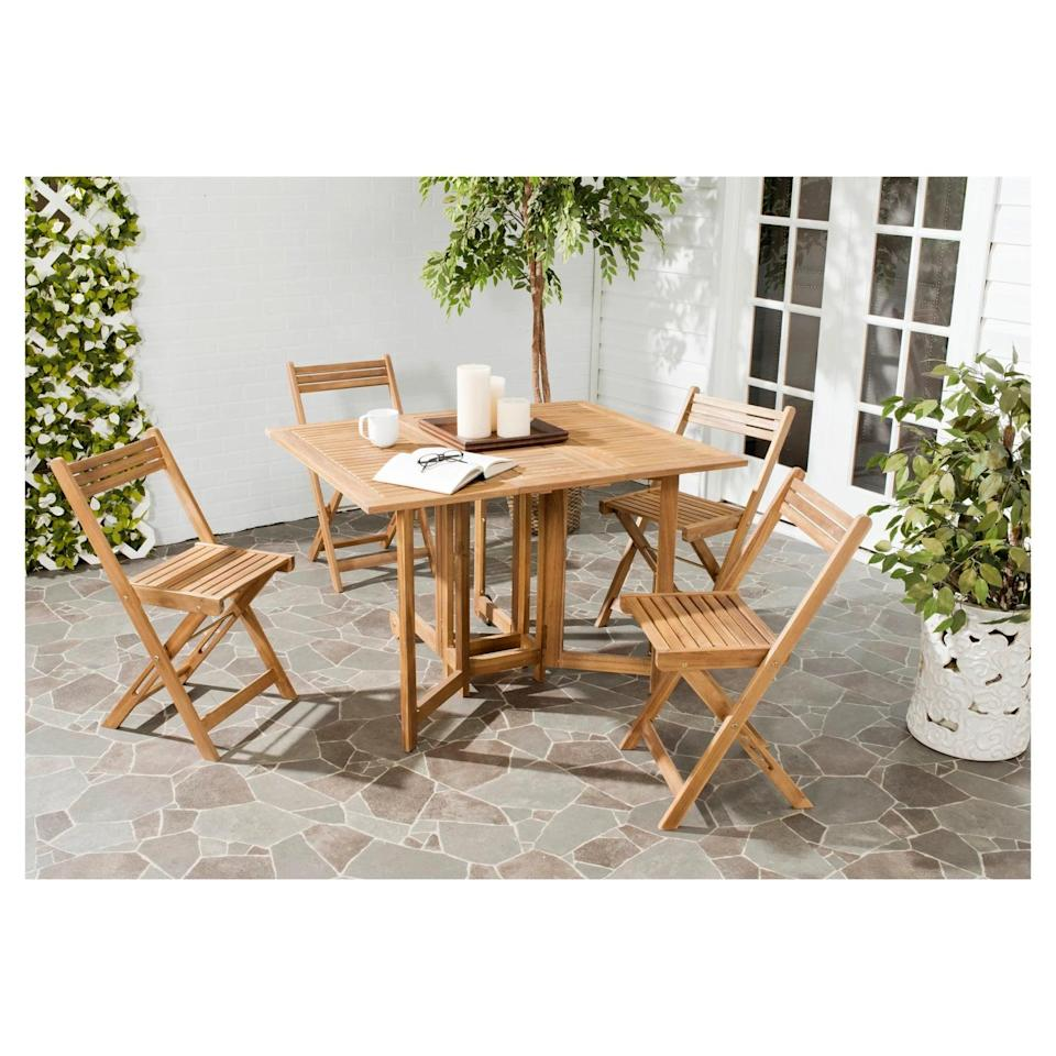 <p>All of the chairs in the <span>Arvin Patio Dining Set</span> ($295) fold and tuck perfectly under its table for ultimate storage.</p>