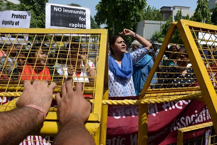 Indian women protest near the Saudi Arabian embassy in New Delhi on September 10, 2015 after the mission's first secretary was accused of holding captive and raping two Nepalese maids in his home (AFP Photo/Money Sharma)