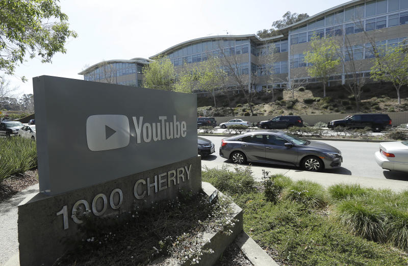 FILE - In this Tuesday, April 3, 2018 file, a YouTube sign is shown across the street from the company's offices in San Bruno, Calif. YouTube's video streaming service went out for more than an hour on Tuesday, Oct. 16, 2018, apparently affecting locations around the world. YouTube acknowledged the outage in a tweet at 9:41 p.m. EDT, noting that it affected YouTube, YouTube Music and YouTube TV.  (AP Photo/Jeff Chiu, File)