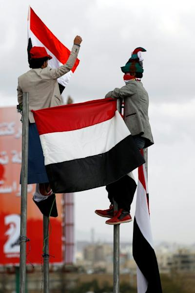 Supporters of Yemen's rebel Huthis and ex-president Ali Abdullah Saleh mark two years since the military intervention by the Saudi-led coalition, in Sanaa on March 26, 2017