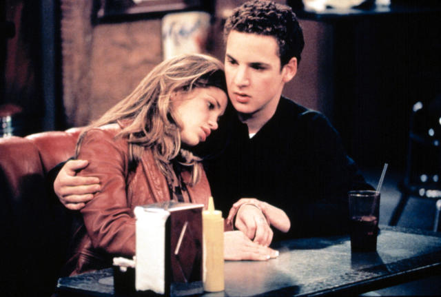 Topanga (Fishel) and Cory (Savage) share an embrace in <em>Boy Meets World</em>. (Photo: Touchstone Television/courtesy Everett Collection)