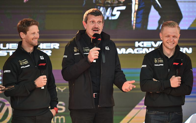 Haas F1 team principal Guenther Steiner (C) speaks with his team's French driver Romain Grosjean (L) and Danish driver Kevin Magnussen (R) during the F1 Live event to introduce the drivers and team principals in Melbourne on March 13, 2019, ahead of the Formula One Australian Grand Prix. (Photo by PETER PARKS / AFP) / -- IMAGE RESTRICTED TO EDITORIAL USE - STRICTLY NO COMMERCIAL USE -- (Photo credit should read PETER PARKS/AFP via Getty Images)