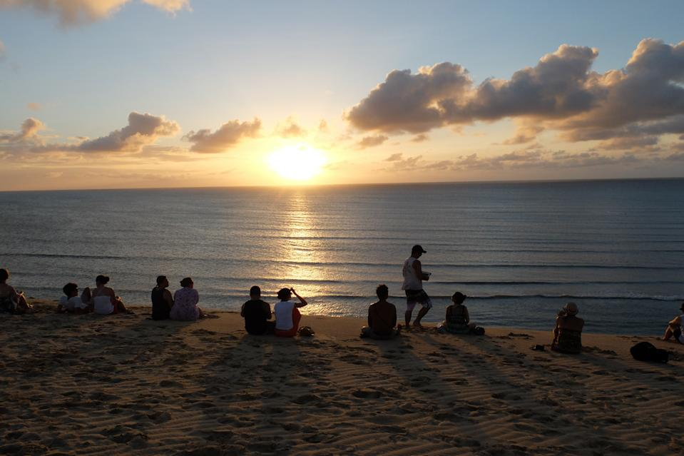 JERICOACOARA, BRAZIL - MAY: People watching the sundown from Duna dos Sol in May 2013 in Jericoacoara, Brazil. (Photo by Mohamed LOUNES/Gamma-Rapho via Getty Images)