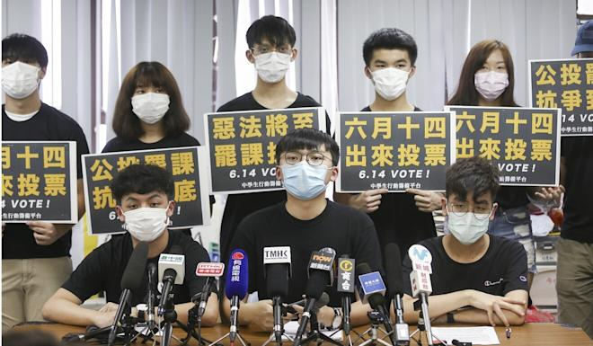 Students, including Carson Tsang Long-hin of Ideologist (front row, left) and Isaac Cheng of the Hong Kong Secondary Schools Actions Platform (front row, middle) hold a press briefing on the proposed strike. Photo: Jonathan Wong