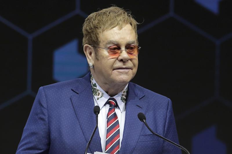 Elton John spoke at the Crystal Awards ceremony on the eve of the World Economic Forum in Davos: AP