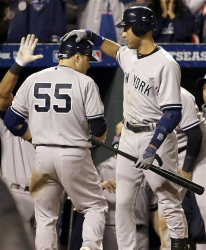 Derek Jeter congratulates Russell Martin after Martin hit a solo HR Sunday against the Orioles. (AP)
