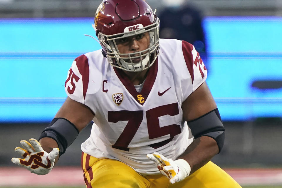 FILE - Southern California offensive lineman Alijah Vera-Tucker (75) is shown during the second half of an NCAA college football game against Arizona in Tucson, Ariz., in this Saturday, Nov. 14, 2020, file photo. Vera-Tucker is a possible first round pick in the NFL Draft, April 29-May 1, 2021, in Cleveland. (AP Photo/Rick Scuteri, File)