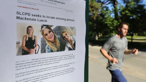 PHOTO: A jogger runs pass a poster of Mackenzie Lueck at Liberty Park in Salt Lake City, June 24, 2019. (Rick Bowmer/AP, FILE)