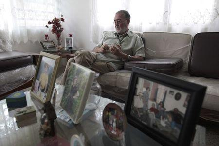 Prudo Jimenez sits at his home during an interview with Reuters in Arecibo, Puerto Rico, November 2, 2016. REUTERS/Alvin Baez
