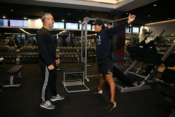 A personal trainer and his client are seen working out in City Gym in Sydney, Australia.