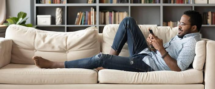 Using investing app on couch