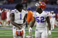Florida linebackers Brenton Cox Jr. (1) and Antwuan Powell (52) walk off the field after the team's 55-20 loss to Oklahoma in the Cotton Bowl NCAA college football game in Arlington, Texas, Wednesday, Dec. 30, 2020. (AP Photo/Ron Jenkins)