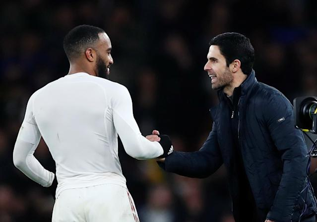 Arteta celebrates with Lacazette after the win over Leeds (REUTERS/Eddie Keogh)