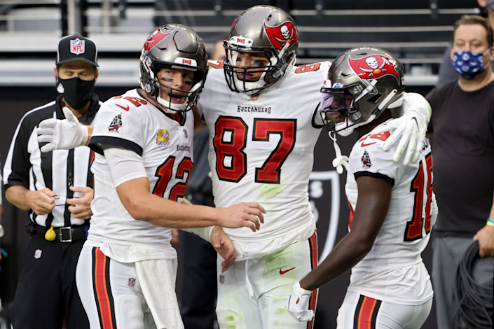 Tampa Bay Buccaneers teammates (from left) Tom Brady, Rob Gronkowski and Tyler Johnson celebrate a touchdown.