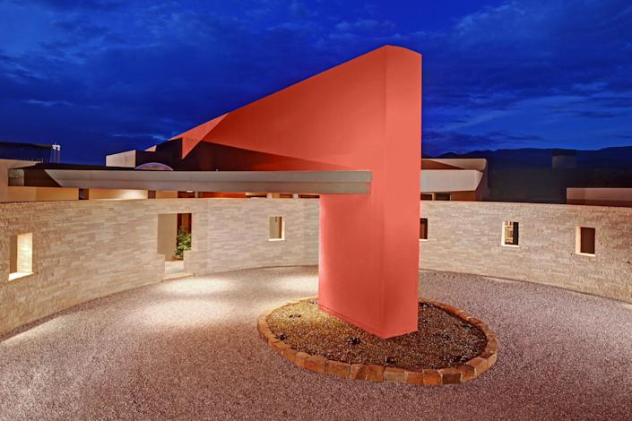 Architect Aaron Bohrer took inspiration from the Pueblo Bonito cultural site in Chaco Canyon for Casa de Vidrio, or House of Glass. The main house is outfitted with slate and bamboo floors and radiant heating and cooling, and it boasts an observation deck, a home theater, and water features. The compound includes a 1,600-square-foot guesthouse, two two-car garages, and a private well.
