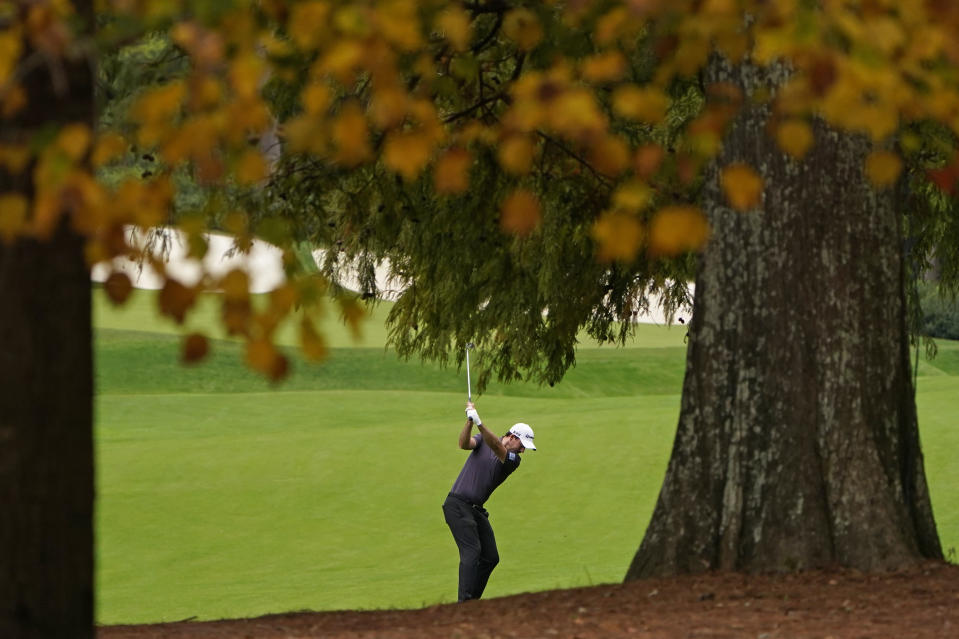 Nick Taylor, of Canada, hits on the 13th hole during a practice round for the Masters golf tournament Tuesday, Nov. 10, 2020, in Augusta, Ga. (AP Photo/Chris Carlson)