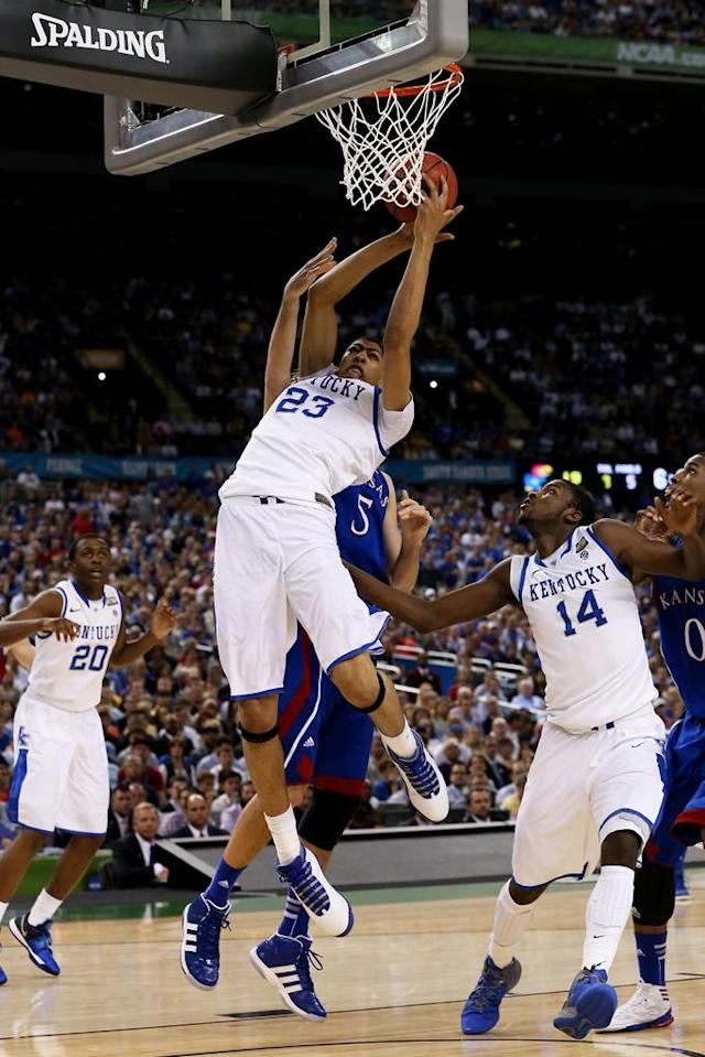 Anthony Davis #23 of the Kentucky Wildcats grabs the ball in front of Jeff Withey #5 of the Kansas Jayhawks in the first half in the National Championship Game of the 2012 NCAA Division I Men's Basketball Tournament at the Mercedes-Benz Superdome on April 2, 2012 in New Orleans, Louisiana. (Photo by Jeff Gross/Getty Images)