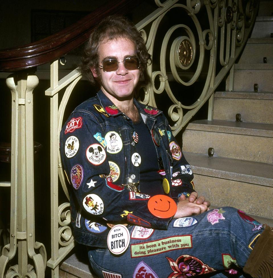 <p>Elton John's style has always veered on the, ah, wild side, but when the star was first coming up his look wasn't as elaborate. Plaster a denim jacket in patches, find some large—and I mean large—sunglasses, and you're there.</p>