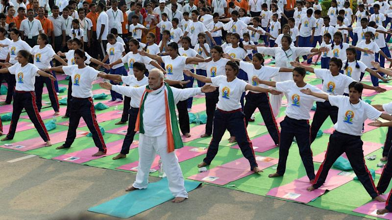 Prime Minister Narendra Modi performs yoga along with thousands of others at a mass yoga session to mark the International Day of Yoga 2015.