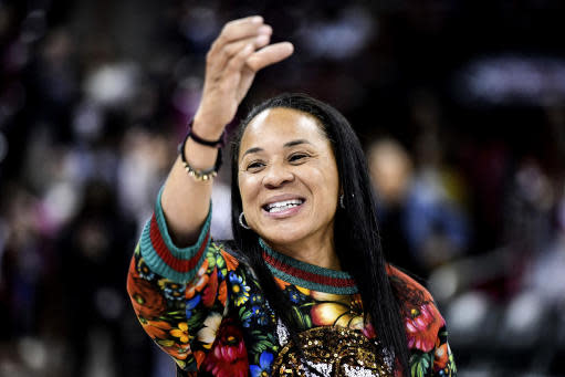 FILE- In this Dec. 15, 2019, file photo, South Carolina head coach Dawn Staley participates in the school anthem after an NCAA college basketball game against Purdue in Columbia, S.C. The veteran Gamecocks coach was announced as The Associated Press women's basketball coach of the year Monday, March 23, 2020. (AP Photo/Sean Rayford, File)