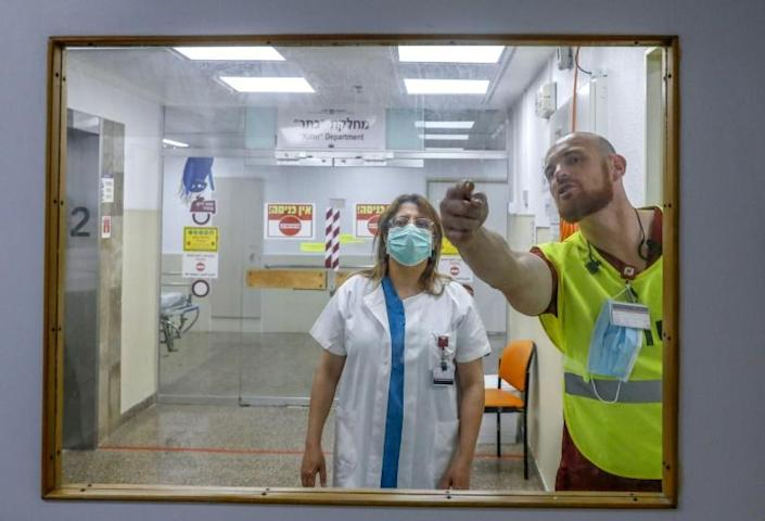 Hussein heads the outbreak response at the Rambam Hospital near Haifa and has been working 12-hour days for months (AFP Photo/Ahmad GHARABLI)