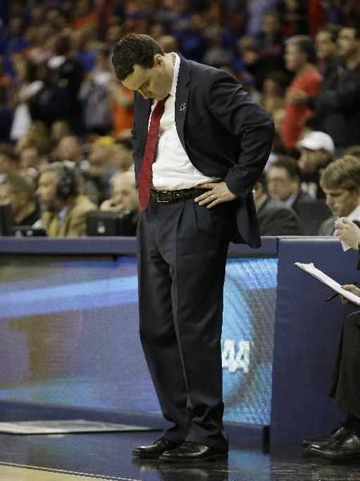 Dayton head coach Archie Miller stands on the court during the second half in a regional final game against Florida at the NCAA college basketball tournament, Saturday, March 29, 2014, in Memphis, Tenn. Florida won 62-52. (AP Photo/Mark Humphrey)