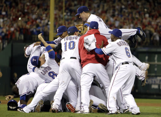FILE - In this Oct. 22, 2010, file photo, Texas Rangers players celebrate after a 6-1 win over the New York Yankees in the deciding Game 6 of baseball's American League Championship Series in Arlington, Texas. (AP Photo/Chris O'Meara, File)