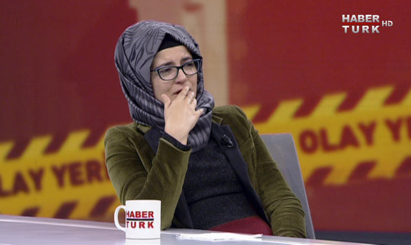 """In this image from TV, Hatice Cengiz, who is Turkish, reacts during an interview on Turkish television channel HaberTurk, Friday Oct. 26, 2018, about the day her finacee Saudi writer Jamal Khashoggi entered the Saudi Arabia Consulate on Oct. 2, and was killed inside. Hatice Cengiz said """"I found myself in a darkness I cannot express"""", and talked about when Khashoggi had gone to the consulate for paperwork related to his planned marriage to Cengiz. (HaberTurk TV via AP)"""