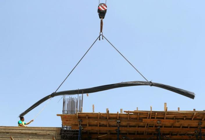 A worker stands on a building under construction in the New Administrative Capital (NAC), east of Cairo