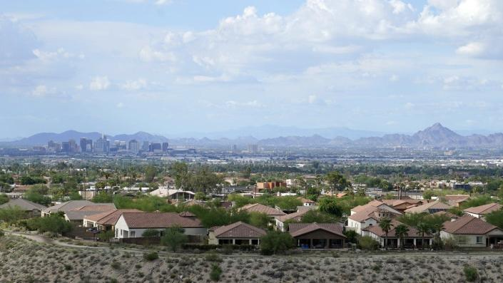 Downtown Phoenix with suburban homes in foreground.