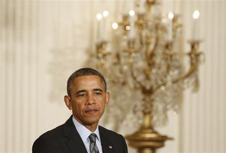 U.S. President Obama pauses as he discusses unemployment, in the East Room of the White House in Washington