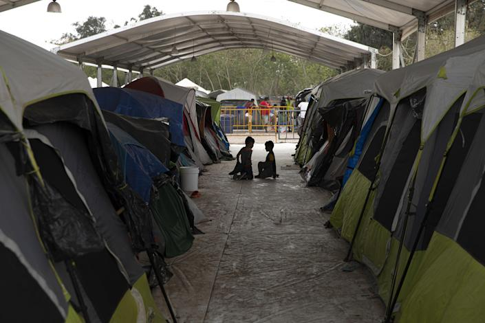 Children play between tents at a makeshift migrant camp in Matamoros, Tamaulipas state, Mexico, on Sunday, March 1, 2020. / Credit: Bloomberg