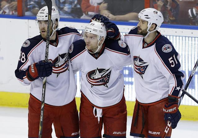 Columbus Blue Jackets center Mark Letestu (55) celebrates with defenseman David Savard (58) and defenseman Fedor Tyutin (51) after scoring a goal in the second period of a hockey game against the Florida Panthers, Saturday, April 12, 2014, in Sunrise, Fla. (AP Photo/Lynne Sladky)
