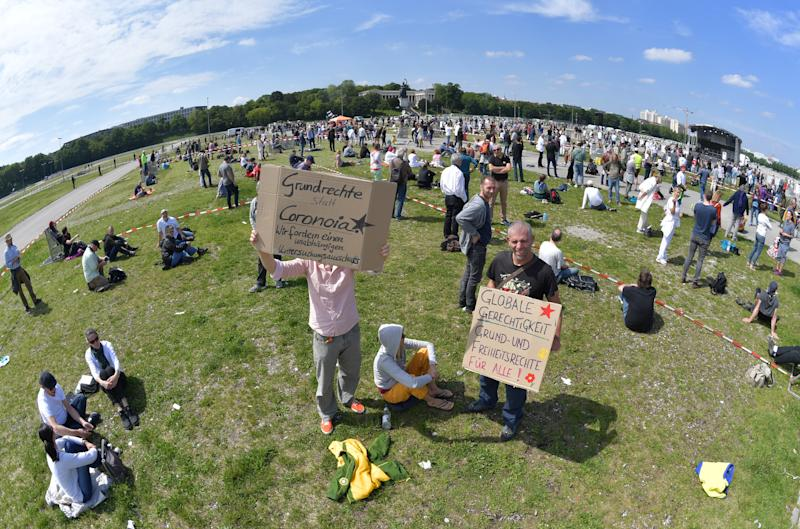 MUNICH, GERMANY - MAY 16: Demonstrators gather to protest against lockdown measures and other government policies relating to the novel coronavirus crisis on May 16, 2020 in Munich, Germany. Thousand of protesters from a wide spectrum of political creeds, from the simply disgruntled to conspiracy enthusiasts, gathered in cities nationwide to protest against government policies and measures many decry as disproportionate and undemocratic. Germany has been easing lockdown measures over recent weeks in an ongoing process. (Photo by Hannes Magerstaedt/Getty Images)