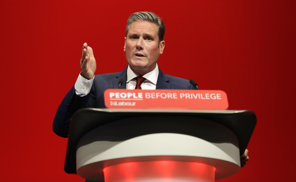 Britain's Shadow Brexit Secretary Keir Starmer speaks on stage during the Labour Party Conference at the Brighton Centre in Brighton, England, Monday, Sept. 23, 2019. (AP Photo/Kirsty Wigglesworth)