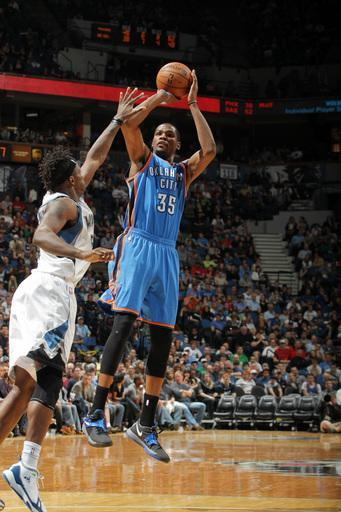 MINNEAPOLIS, MN - APRIL 14: Kevin Durant #35 of the Oklahoma City shoots against Martell Webster #5 of the Minnesota Timberwolves on April 14, 2012 at Target Center in Minneapolis, Minnesota. (Photo by David Sherman/NBAE via Getty Images)