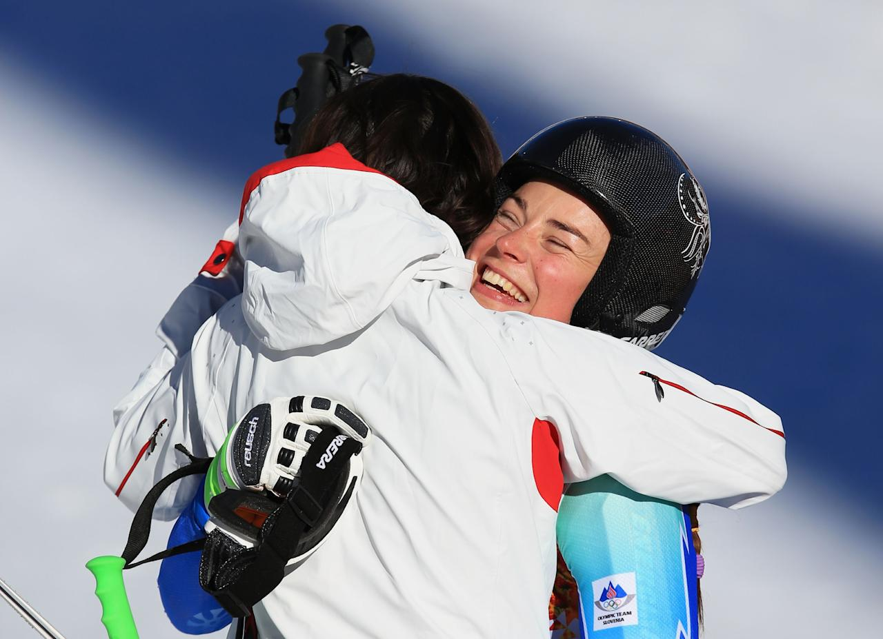 SOCHI, RUSSIA - FEBRUARY 12: Tina Maze of Slovenia (R) hugs Dominique Gisin of Switzerland after her run during the Alpine Skiing Women's Downhill on day 5 of the Sochi 2014 Winter Olympics at Rosa Khutor Alpine Center on February 12, 2014 in Sochi, Russia. (Photo by Richard Heathcote/Getty Images)