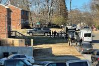 FILE PHOTO: Law enforcement officers gather to investigate information arising the day after a downtown Nashville explosion, outside a duplex house in Antioch